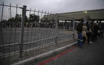 Long queues seen at the Mitchells Plain bus terminal in Cape Town on Wednesday morning as commuters waited for alternative transport to get them to work amid nationwide bus strike. Picture: Cindy Archillies/EWN