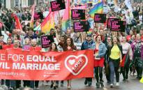 Gay rights campaigners take part in a march through Belfast on July 1, 2017 to protest against the ban on same-sex marriage. Picture: AFP.