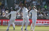 SA bowler Kagiso Rabada (centre) celebrates the dismissal of Sri Lanka batsman Dinesh Chandimal during the second Test between South Africa and Sri Lanka on 3 January 2017 at Newlands Cricket Stadium in Cape Town. Picture: AFP.