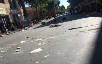 Streets of Braamfontein filled with rubble as Wits University students continue the Fees Must Fall protests. Picture: Clement Manyathela/EWN.