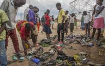 People check for their relatives among lost shoes after several people got injured and eight left dead in a stampede at the Bingu National Stadium in Lilongwe during the celebrations of the republic's 53rd anniversary on 6 July, 2017. Picture: AFP