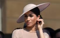 Meghan, Duchess of Sussex, attends a garden party at Buckingham Palace on 22 May 2018. Picture: Reuters