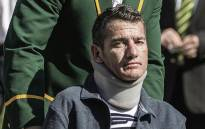 Former Sprinbok captain Francois Pienaar assists former teammate flyhalf Joost van der Westhuizen (Front) during a re-enactement of the team photo from the 1995 Rugby World cup victory on June 24, 2015. Picture: AFP