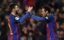 Barcelona's Argentinian forward Lionel Messi (L) celebrates with Barcelona's Brazilian forward Neymar (R) after scoring a goal during the Spanish league football match FC Barcelona vs RC Celta de Vigo at the Camp Nou stadium in Barcelona on 4 March 2017.  Picture: AFP