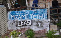 FILE: A sign welcoming visitors to Imizamo Yethu informal settlement in Hout Bay. Picture: Aletta Gardner/EWN