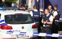 Police stand as they secure the area around a police building in the southern Belgian city of Charleroi following a machete attack on August 6, 2016. Picture: AFP