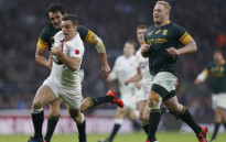 England's fly half George Ford (C) runs through the South African defence on his way to score a try during the rugby union test match between England and South Africa at Twickenham stadium in southwest London on 12 November 2016. Picture: AFP