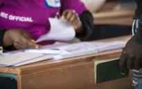 FILE: IEC officials process voters. Picture: Thomas Holder/EWN.