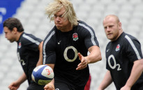 FILE:England's lock Mouritz Botha (C) passes the ball during a training session at the Stade de France in Saint-Denis, north of Paris, on March 10, 2012, on the eve of their rugby union 6 Nations tournament match against England. Picture: AFP.