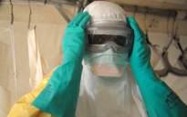 Health specialists prepare for work in an isolation ward for patients at the Doctors Without Borders facility in Gukedou, southern Guinea. Picture: AFP.