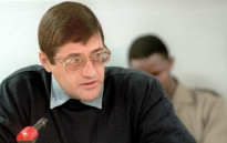 Eugene de Kock speaks to the judge at a Truth and Reconcilation Commision, Pretoria, 24 May 1999. Picture: AFP.