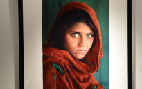 FILE: 'Afghan Girl, 1984' by photographer Steve McCurry on display as part of The National Geographic Collection: The Art of Exploration at Christie's. Picture: AFP.