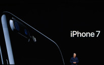 FILE: Apple CEO Tim Cook introduces the new iPhone 7 during an event inside Bill Graham Civic Auditorium in San Francisco, California on 7 September 2016. Picture: AFP.
