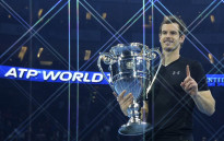 Britain's Andy Murray poses holding the ATP World Number One trophy after winning the men's singles final against Serbia's Novak Djokovic on the eighth and final day of the ATP World Tour Finals tennis tournament in London on November 20, 2016. Picture: AFP.