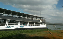 A party boat ferrying about 200 people caught fire at the Hartbeespoort Dam. Picture: iWitness.