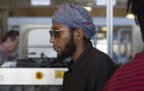 FILE: US hip hop artist and actor, Yasiin Bey, popularly known as Mos Def, walks into the Bellville Magistrates Court. Picture: AFP.
