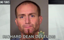 A screengrab showing an Oregon burglar, Richard Dean Defeudis, who broke into a couple's house and stripped naked and climbed into their bed with them.