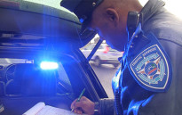 Traffic Officer who forms part of the Ghost Squad writing out a ticket in Cape Town.