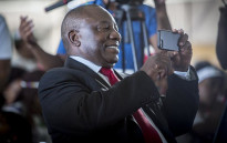 Deputy President Cyril Ramaphosa takes a video on his cellphone during a World Aids Day event in Daveyton, east of Johannesburg on 1 December 2016. Picture: Reinart Toerien/EWN