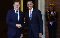 Spanish Prime Minister Mariano Rajoy (L) shakes hand with US president Barack Obama at Moncloa palace in Madrid on July 10, 2016. Obama said he will cut short a foreign trip and visit Dallas next week as the shooting rampage by the black army veteran, who said he wanted to kill white cops, triggered urgent calls to mend troubled race relations in the United States. Picture: AFP.