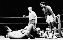 US boxer Muhammad Ali, born Cassius Marcellus Clay Jr. on 17 January, 1942, three-time World Heavyweight Champion and winner of an Olympic Light-heavyweight gold medal, shouts at a Japanese fighter during an exhibition fight in Tokyo, 1 July 1976. Picture: AFP.