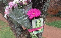 A picture of Chanelle Henning is placed on a tree with flowers at the spot where she died on 8 November, 2011. The Pretoria mother was killed shotly after dropping of her son in Faerie Glen. Picture: Barry Bateman/EWN.