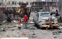 Yemenis inspect the site of a suicide car bombing claimed by the Islamic State group on 269 August 2016 at an army recruitment centre in the southern Yemeni city of Aden. Yemeni security officials told AFP that the attacker drove an explosives-laden vehicle into a gathering of army recruits at a school in northern Aden, killing at least 60. Picture: AFP