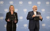 Iranian Foreign Minister Mohammad Javad Zarif (R) and EU foreign policy chief Federica Mogherini hold a press conference at the E3/EU+3 and Iran talks at the International Atomic Energy Agency headquarters in Vienna on 16 January 2016. Picture: AFP.