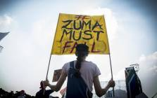 A woman holds up a banner at the Freedom Movement rally against the leadership of President Jacob Zuma in Pretoria on 27 April 2017. Picture: Reinart Toerien/EWN