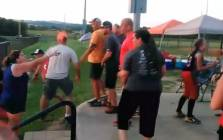 Video shows almost a dozen parents erupt into a massive fight at a girls softball tournament.