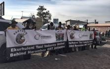 Members of taxi association Santaco gathered at Germiston taxi rank ahead of a strike on 20 March 2018. Picture: Ihsaan Haffejee/EWN