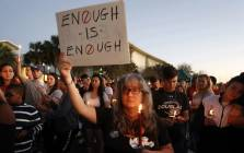 Mourners stand during a candlelight vigil for the victims of Marjory Stoneman Douglas High School shooting in Parkland, Florida, on 15 February 2018. Picture: AFP.