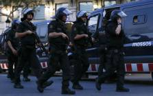 Spanish policemen walk in a cordoned off area after a van ploughed into the crowd, killing 13 persons and injuring over 80, on the Rambla in Barcelona on 17 August 2017. Picture: AFP