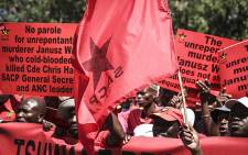 An SACP flag waves in the wind during a tripartite alliance march through Pretoria's CBD in support of Justice Minister Michael Masutha's decision to appeal the parole granted to Chris Hani's killer, Janusz Walus. Picture: Reinart Toerien/EWN.