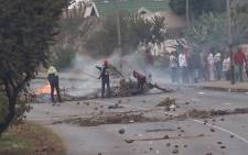 Police clashed with residents of Eldorado Park who demanded land on which to build houses. Officers fired rubber bullets to disperse the crowds which barricaded roads and looted stores. Picture: Louise McAuliffe/EWN.