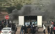 A delivery truck was looted by protesters in Attridgeville. Picture: Supplied.