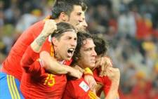 Spain soccer team, including Carles Puyol, celebrate after scoring a goal. Picture: AFP