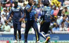 Sri Lanka players celebrate the fall of a wicket. Picture: AFP
