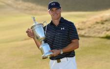 Jordan Spieth of the United States poses with the trophy after winning the 115th US Open Championship at Chambers Bay on 21 June, 2015 in University Place, Washington. Picture: AFP.