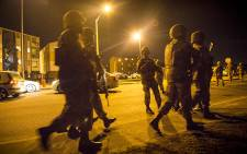 FILE: Members of the SANDF gather outside a blocks of flats in a known gang area in Ottery, Cape Town, during a Fiela Operation conducted during the early hours of the morning. Picture: Thomas Holder/EWN