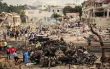 A picture taken on 15 October 2017 shows a general view of the scene of the explosion of a truck bomb in the centre of Mogadishu. Picture: AFP.