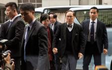 Former Hong Kong chief executive Donald Tsang (centre R) arrives with his wife Selina Tsang (centre L) at the High Court for sentencing after being found guilty of misconduct in Hong Kong on 20 February, 2017. Picture: AFP.