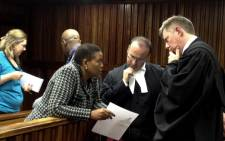 FILE: IEC Chair Pansy Tlakula confers with her legal team at the Electoral Court during a hearing into her credibility. Picture: Govan Whittles/EWN.