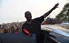 FILE: Samura Kamara, from Sierra Leone's All People's Congress, waves to supporters during a campaign rally on 24 March 2018 in Freetown. Picture: AFP