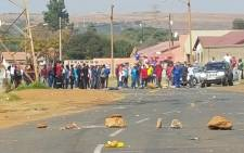 Violent protests erupted in Ennerdale as angry residents demanded demanding houses. Picture: Louise McAuliffe/EWN