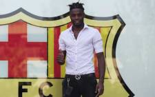 Barcelona new signing Cameroonian midfielder Alex Song poses in Barcelona on August 20, 2012. Picture: AFP.