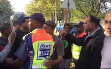 Screengrab of a scuffle outside Military Museum between Black First Land First and Save SA members.