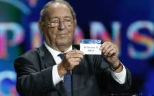 Spain's former player Francisco Gento presents the name AS Monaco FC, during the draw for the 2014/2015 European Champions League group stages, on 28 August, 2014 in Monaco. Picture: AFP.