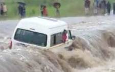 Taxi stranded during flood in Kwaggafontein. Passenger and rescue member drowned. Picture: Twitter @SAPoliceService.