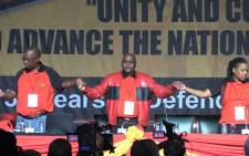 FILE. Cosatu President Sdumo Dlamini holds hands with union leadership during the opening day of the national congress. Picture: Vumani Mkhize/EWN.